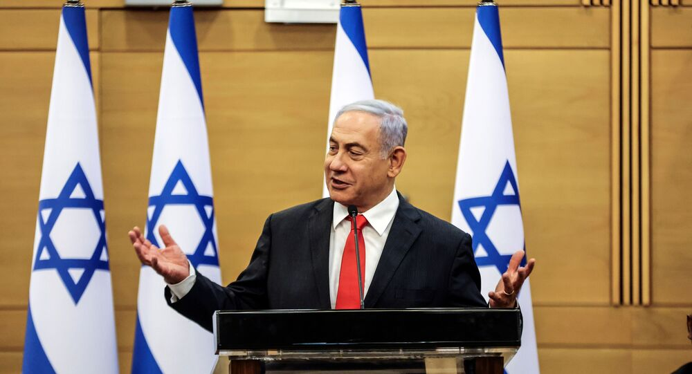 Leader of Israeli Opposition Benjamin Netanyahu speaks during a meeting with his Likud party in the Knesset, the Israeli parliament, in Jerusalem June 14, 2021.