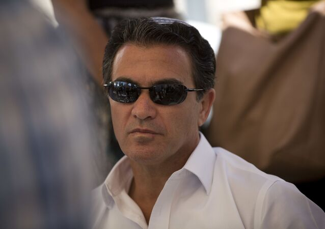 In this Sunday, July 3, 2016. photo, Yossi Cohen, director of Mossad, Israel's state intelligence agency, attends the funeral of Miki Mark who was killed in an shooting attack in the West Bank Friday, in Jerusalem.