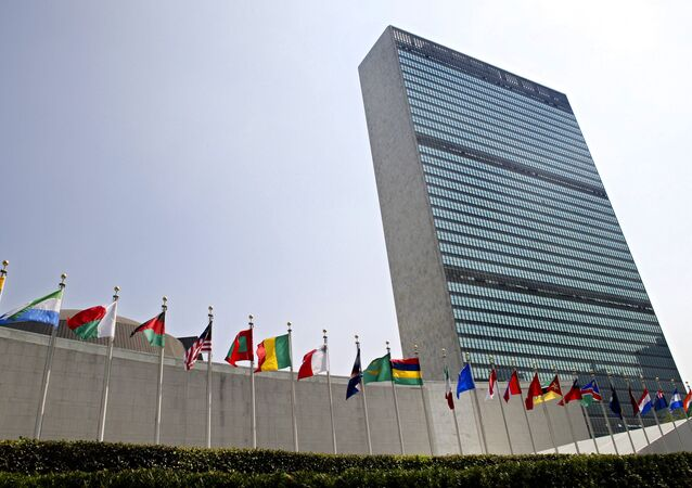 In this Sept. 13, 2005, file photo, the flags of member nations fly outside the General Assembly building at the United Nations headquarters in New York.
