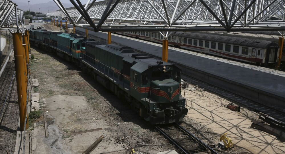 In this picture taken on 10 July 2017, a train arrives at Tehran's central station. Iran Railways says it has signed a preliminary agreement with Italy's state railway to construct two high-speed links in Iran.