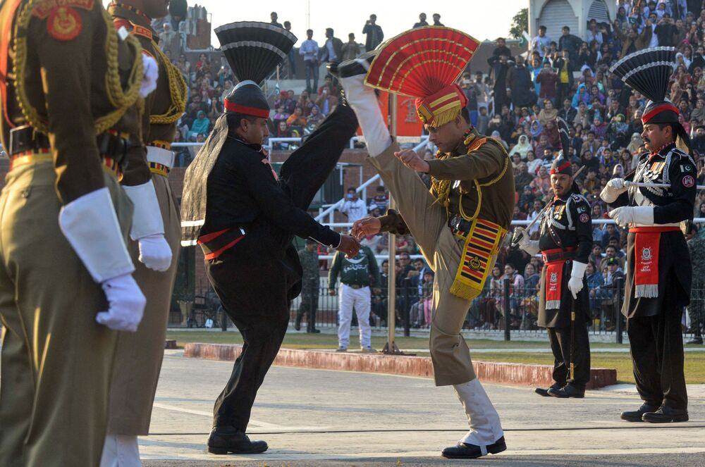 The ceremony of lowering flags at the border in the city of Wagah, which is conducted by the Indian border security forces and Pakistani rangers.