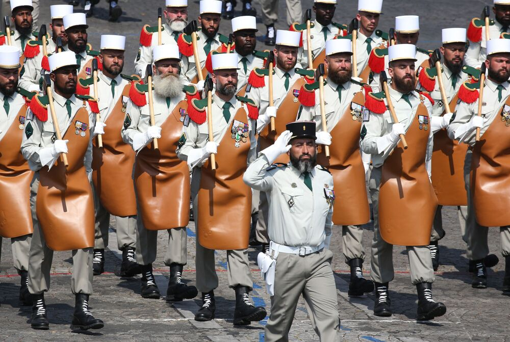 Sappers of the French Foreign Legion. Orange aprons are designed to accommodate various military tools in the field. Legion veterans must wear beards.