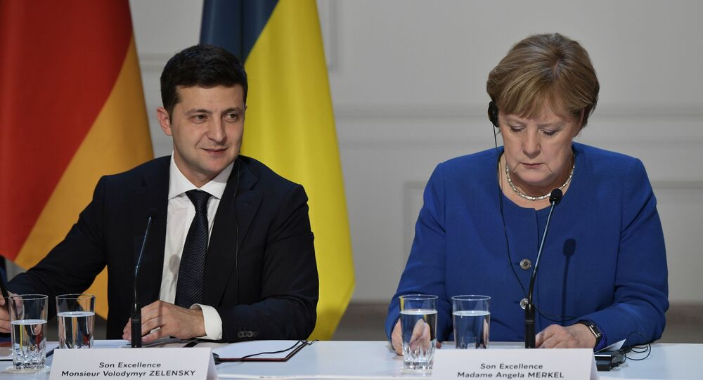 Ukrainian President Volodymyr Zelensky and German Chancellor Angela Merkel attend a joint news conference following a meeting of the Normandy Four leaders at the Elysee Palace in Paris, France. 2019.