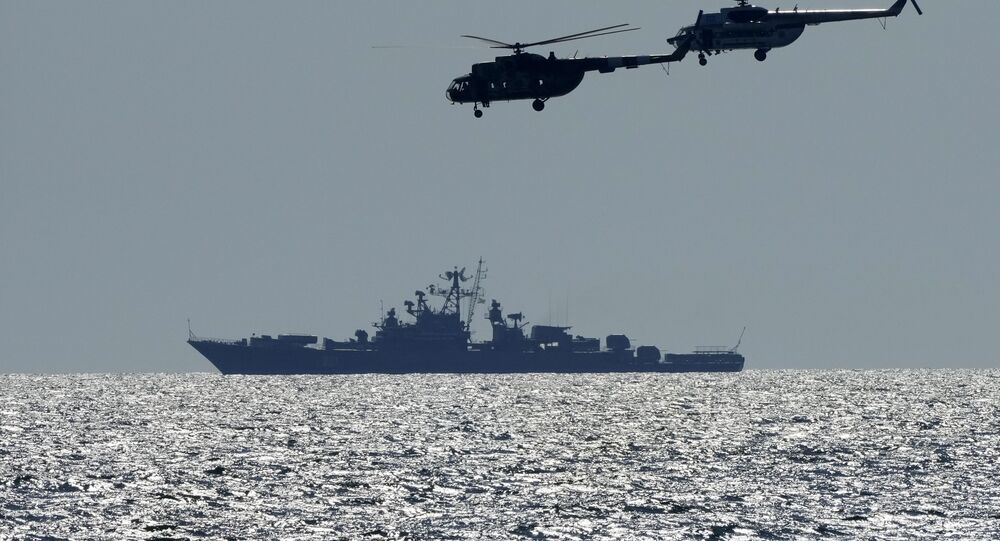 Ukrainian helicopters fly over a Russian warship during Sea Breeze 2021 maneuvers, in the Black Sea, Friday, July 9, 2021