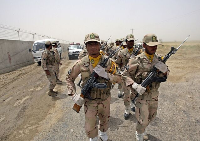 In this Tuesday, July 19, 2011 file photo, a group of Iranian border guards march at the eastern border of Iran shared with Pakistan and Afghanistan near Zabol, Sistan and Baluchestan Province, Iran.