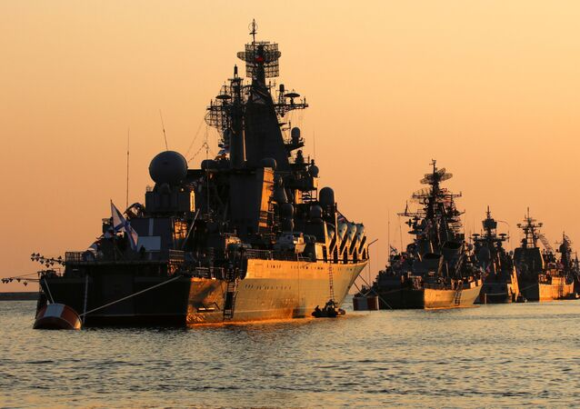 A view shows Russian warships on sunset ahead of the Navy Day parade in the Black Sea port of Sevastopol, Crimea July 27, 2019.