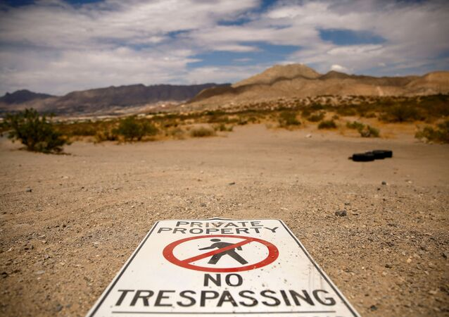A sign is seen in the desert near the border between Mexico and the United States in Sunland Park, New Mexico, U.S., June 23, 2021.