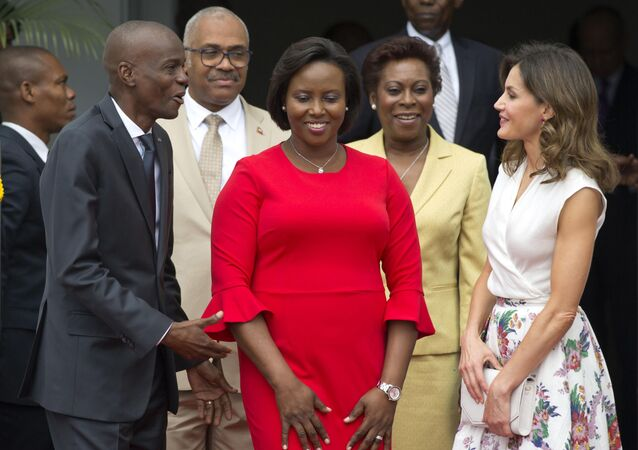 In this May 23, 2018, file photo, Haiti's President Jovenel Moise, left, and First Lady Martine Moise, in red, receive Spain's Queen Letizia Ortiz at the national Palace in Port-au-Prince, Haiti, Wednesday, May 23, 2018.