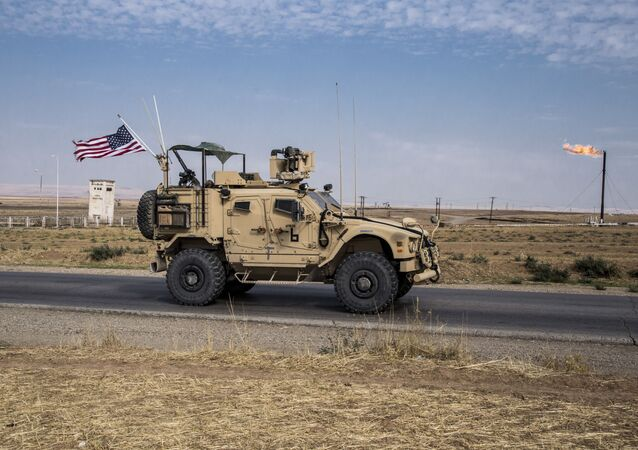 In this Monday, Oct. 28, 2019 file photo, U.S. forces patrol Syrian oil fields, in eastern Syria.President Donald Trump's decision to dispatch new U.S. forces to eastern Syria to secure oil fields is being criticized by some experts as ill-defined and ambiguous.