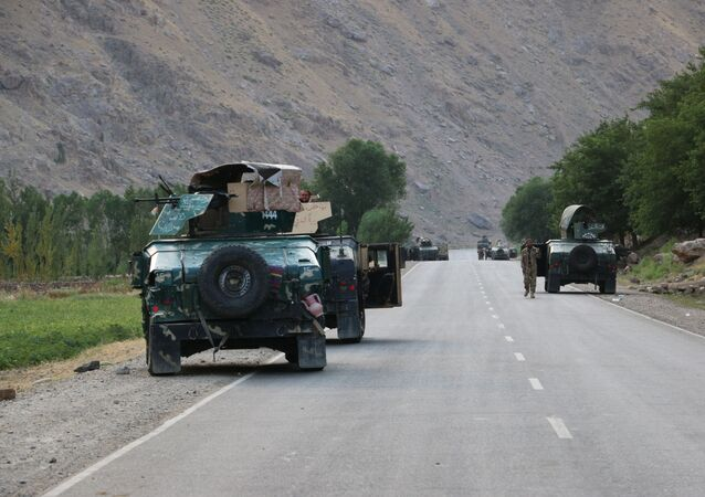 Afghan soldiers pause on a road at the front line of fighting between Taliban and Security forces,  near the city of Badakhshan, northern Afghanistan, Sunday, July. 4, 2021.
