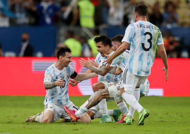 Argentina's Lionel Messi celebrates with teammates after winning the Copa America