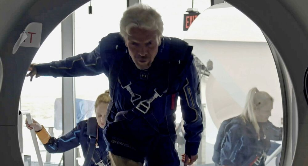 Richard Branson and Virgin Galactic crew members enter the company's passenger rocket plane, the VSS Unity, in a still image from undated handout video taken at Spaceport America near Truth or Consequences, New Mexico, US