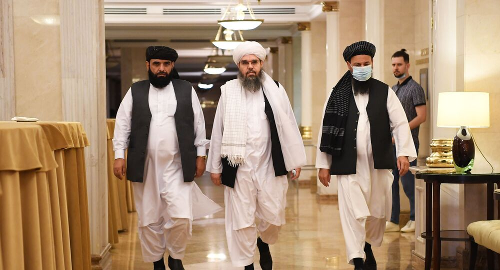 Taliban envoys in Moscow before the start of a press conference. 9 July, 2021.