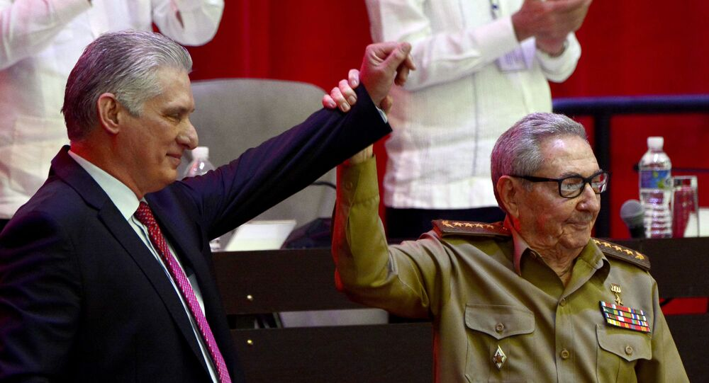 Raul Castro, right, raises the hand of Cuban President Miguel Diaz-Canel after Diaz-Canel was elected First Secretary of the Communist Party at the closing session of Cuban Communist Party's  8th Congress at the Convention Palace in Havana, Cuba, Monday, April 19, 2021.