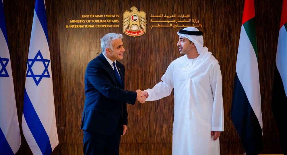 Israel's Foreign Minister Yair Lapid shakes hands with United Arab Emirates' Foreign Minister Sheikh Abdullah bin Zayed al-Nahyan in Abu Dhabi, UAE June 29, 2021.