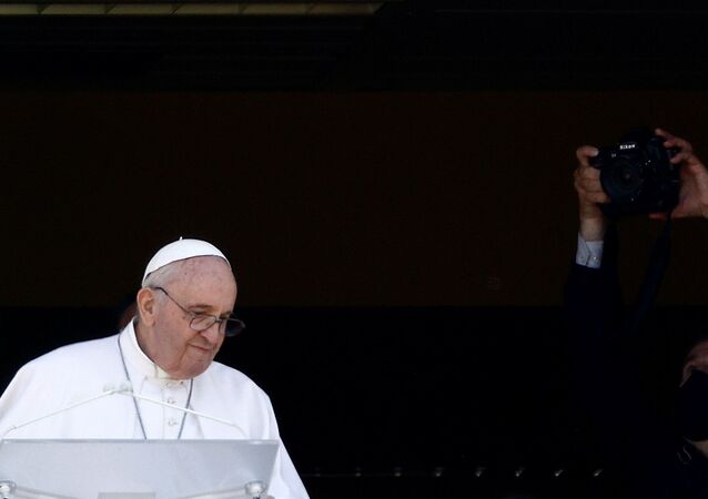 Pope Francis leads the Angelus prayer from a balcony of the Gemelli hospital, as he recovers following scheduled surgery on his colon, in Rome, Italy, July 11, 2021.