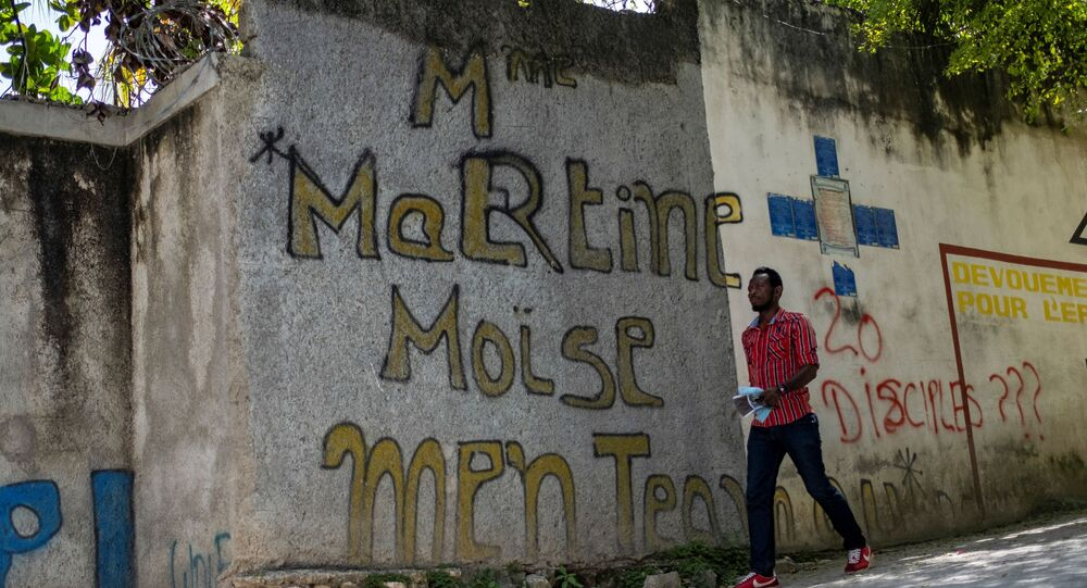 A man walks past a graffiti that reads Martine Moise near the house where President Jovenel Moise was assassinated, in Port-au-Prince, Haiti July 11, 2021.