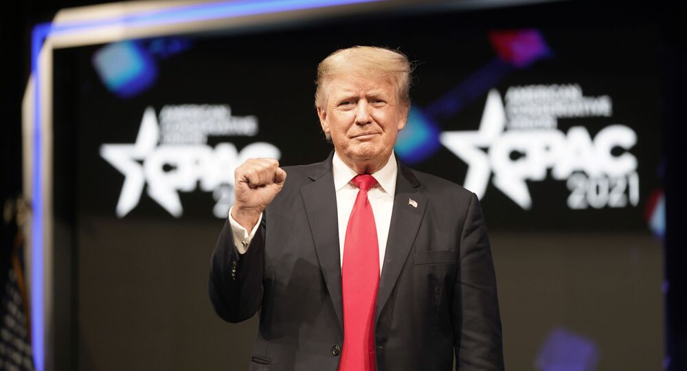 Former president Donald Trump raises his fist before speaking at the Conservative Political Action Conference (CPAC) Sunday, July 11, 2021, in Dallas.