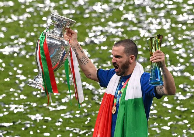 Soccer Football - Euro 2020 - Final - Italy v England - Wembley Stadium, London, Britain - July 11, 2021 Italy's Leonardo Bonucci celebrates with the trophy after winning Euro 2020