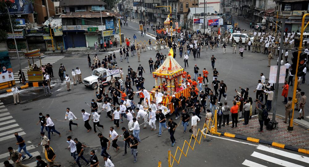 Hindu devotees pull a Rath or a chariot of Lord Jagannath, along a road escorted by police during the annual Rath Yatra, or chariot procession, during the ongoing coronavirus disease (COVID-19) outbreak, in Ahmedabad, India, July 12, 2021