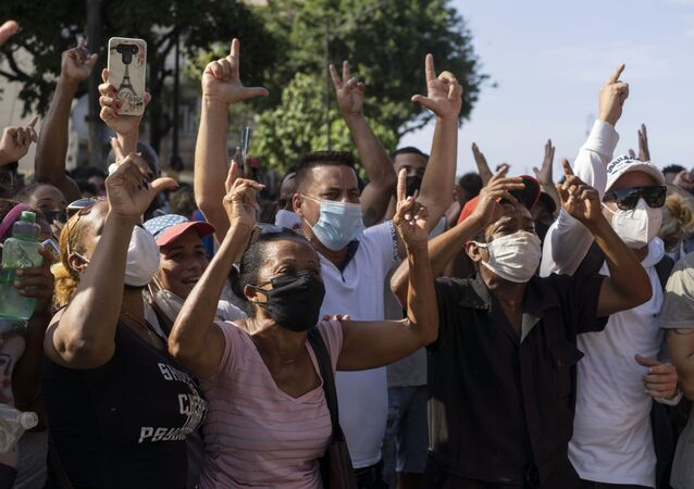 Anti-government protesters march in Havana, Cuba, Sunday, 11 July 2021