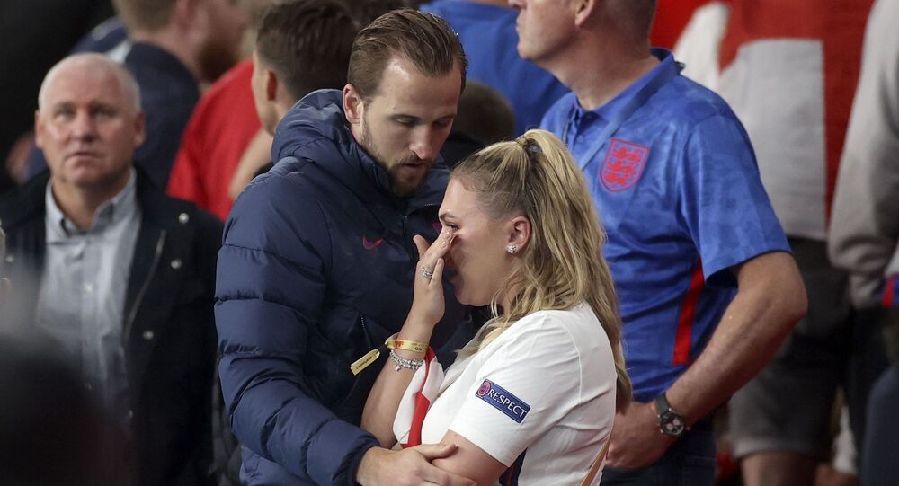 England's Harry Kane embraces his wife Kate at the end of the Euro 2020 soccer championship final match between England and Italy at Wembley stadium in London on Sunday 11 July 2021.
