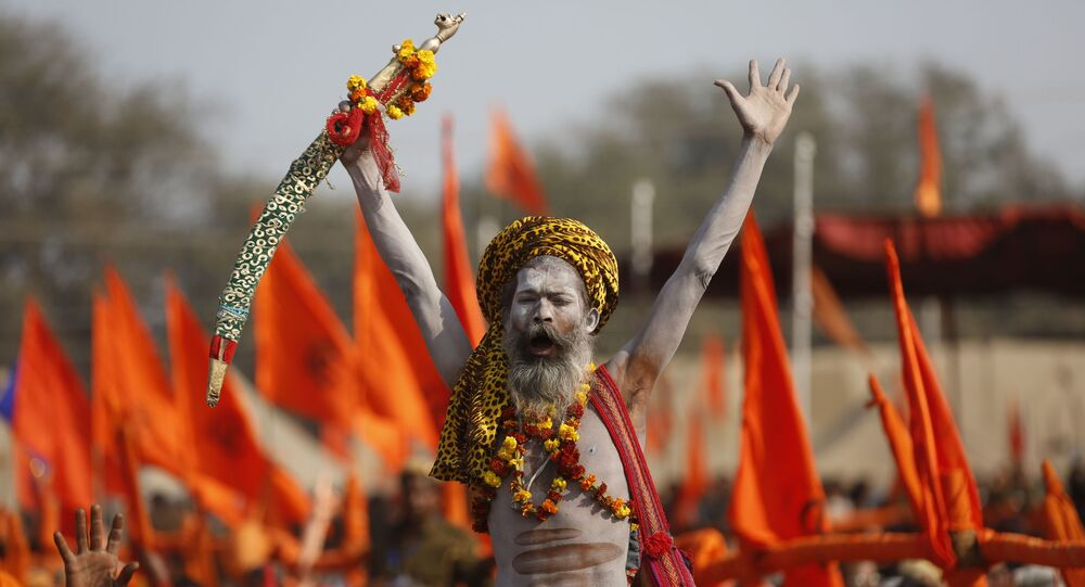 An Indian Hindu holy man shouts slogans during a meeting organized by the Vishva Hindu Parishad or the World Hindu Council at Sangam, the confluence of rivers the Ganges and the Yamuna during the annual Magh Mela festival in Allahabad, India, Friday, Jan. 19, 2018