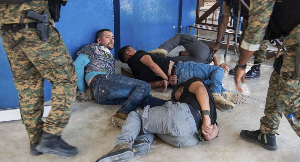 Suspects in the assassination of Haiti's President Jovenel Moise are tossed on the floor after being detained, at the General Direction of the police in Port-au-Prince, Haiti, Thursday, July 8, 2021