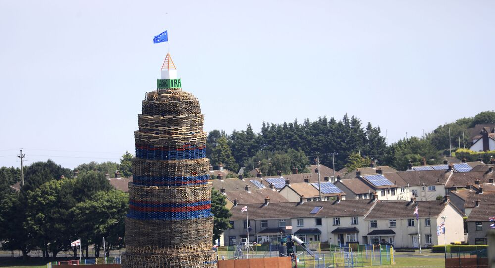 A loyalist bonfire towers above houses in the Craigyhill estate in Larne, Northern Ireland