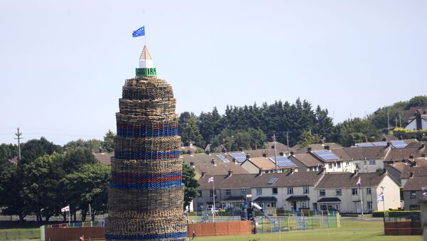 A loyalist bonfire towers above houses in the Craigyhill estate in Larne, Northern Ireland - Sputnik International