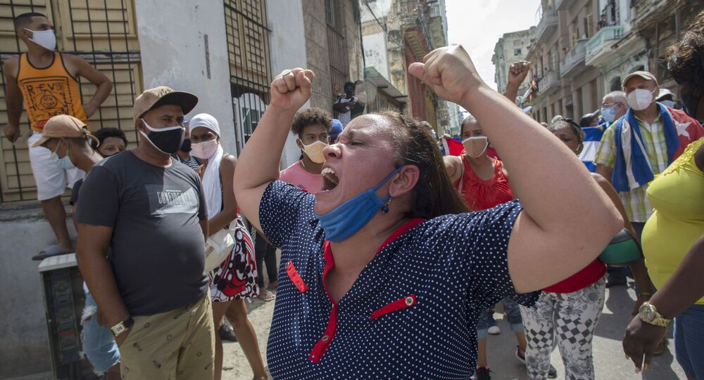 A woman shouts pro-government slogans as anti-government protesters march in Havana, Cuba, Sunday, July 11, 2021