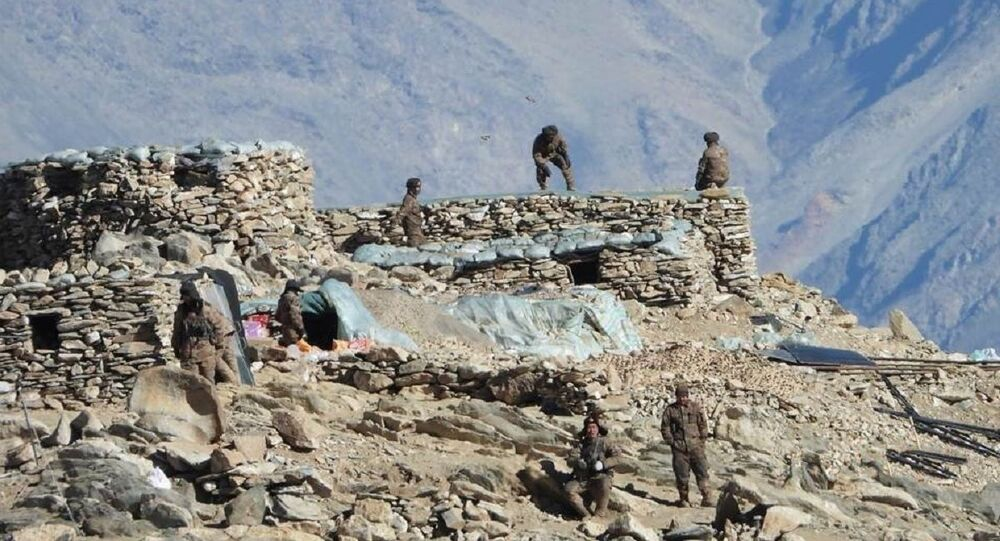 This photograph from the Indian Army, apparently shows Chinese troops dismantling bunkers at Pangong Tso region, in Ladakh along the India-China border on Monday, 15 February 2021.