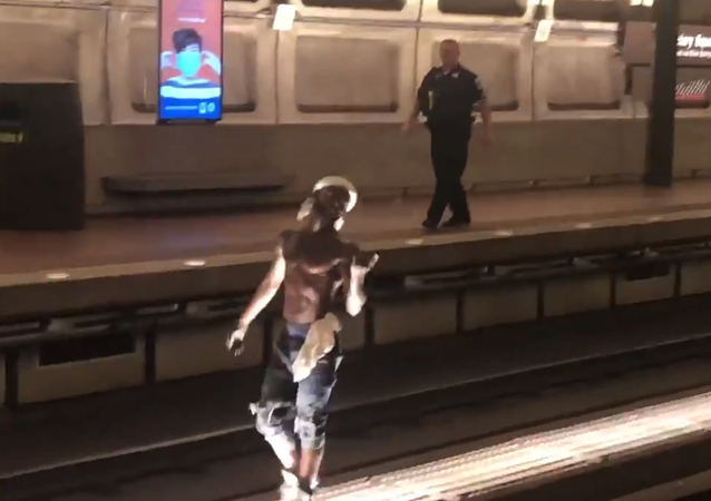 Screenshot from a video allegedly filmed inside the Washington DC Metro, where an unidentified man is seen walking on the tracks