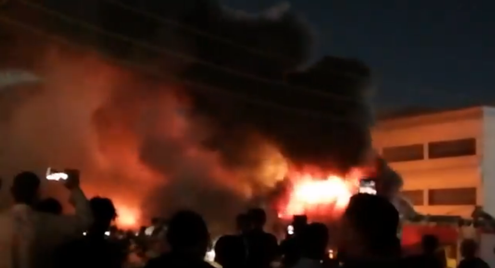 Screenshot from a video allegedly showing the Al-Hussein coronavirus hospital in Iraq engulfed in flames