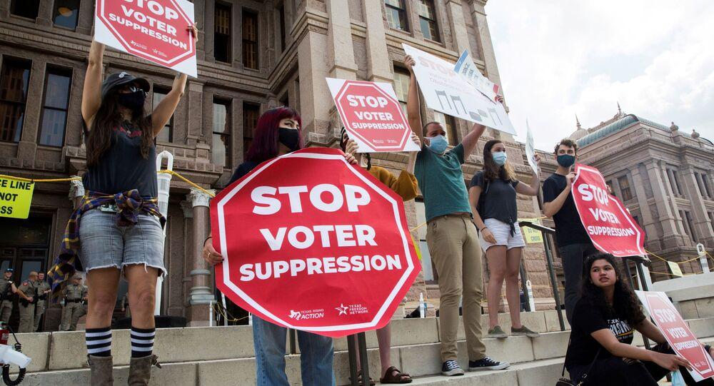 Voting rights activists gather during a protest against Texas legislators who are advancing a slew of new voting restrictions in Austin, Texas, U.S., May 8, 2021