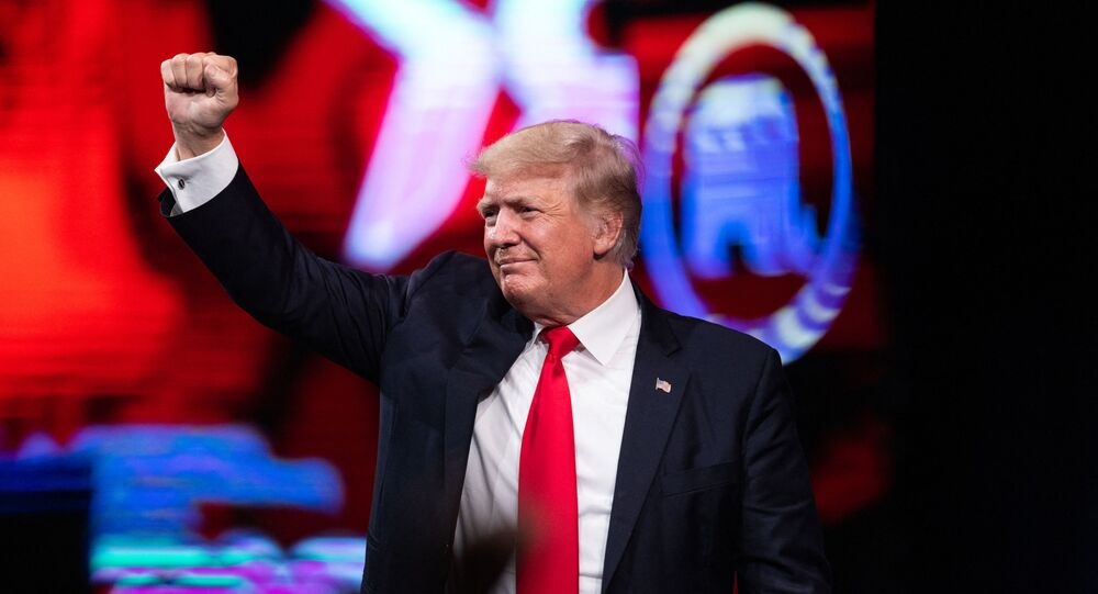 Former US President Donald Trump pumps his fist as he walks off after speaking at the Conservative Political Action Conference (CPAC) in Dallas, Texas on July 11, 2021
