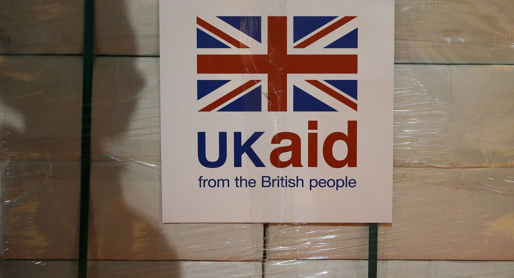 A UK aid label is attatched to a box containing kitchen sets, stored at a UK Aid Disaster Response Centre where humanitarian supplies are being collected to be airlifted to Iraq at Cotswold Airport near the village of Kemble, Gloucestershire, southern England on August 14, 2014