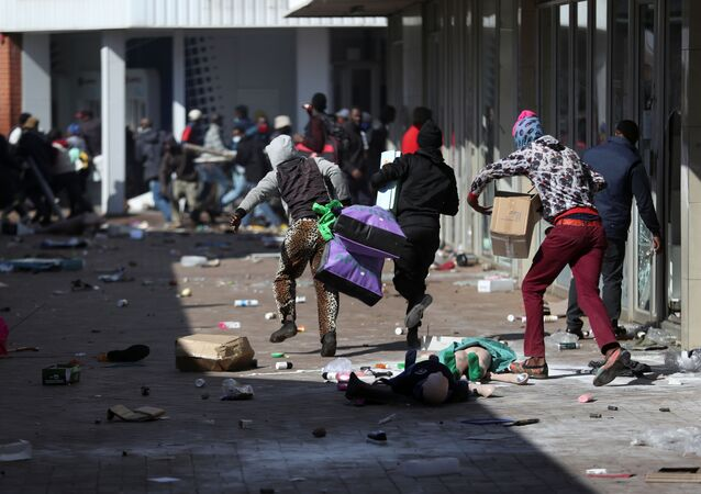 Demonstrators on 12 July 2021 loot stores in Katlehong - about 16 miles south-east of Johannesburg, South Africa - as protests continue in after the imprisonment of former South African President Jacob Zuma.