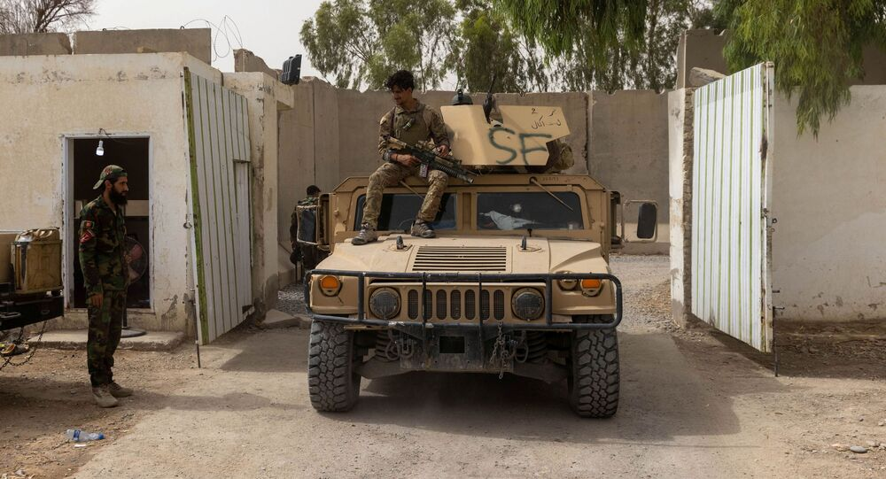 A member of Afghan Special Forces sits on the rooftop of his humvee as he arrives at the base after heavy clashes with Taliban during the rescue mission of a policeman besieged at a check post, in Kandahar province, Afghanistan, July 13, 2021. REUTERS/Danish Siddiqui