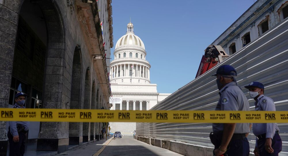 A police line is seen blocking a road leading to the National Capitol Building, in Havana, Cuba, July 12, 2021.