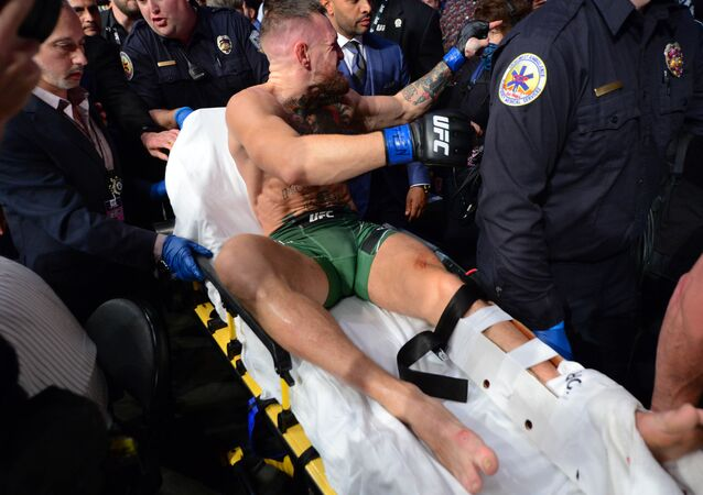 Jul 10, 2021; Las Vegas, Nevada, USA; Conor McGregor is carried off a stretcher following an injury suffered against Dustin Poirier during UFC 264 at T-Mobile Arena.