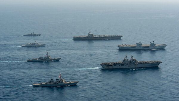 Ships of the UK Carrier Strike Group, USS Ronald Reagan Carrier Strike Group, and Iwo Jima Amphibious Ready Group operate in formation in the Gulf of Aden, July 12. - Sputnik International