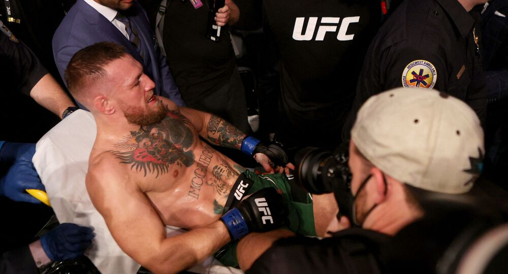 (FILES) In this file photo Conor McGregor of Ireland is carried out of the arena on a stretcher after injuring his ankle in the first round of his lightweight bout against Dustin Poirier during UFC 264: Poirier v McGregor 3 at T-Mobile Arena on July 10, 2021 in Las Vegas, Nevada.