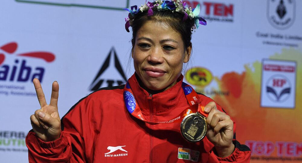 Mary Kom of India gestures with her gold medal after winning the 45-48 kg category final fight at the 2018 AIBA Women's World Boxing Championships in New Delhi on November 24, 2018