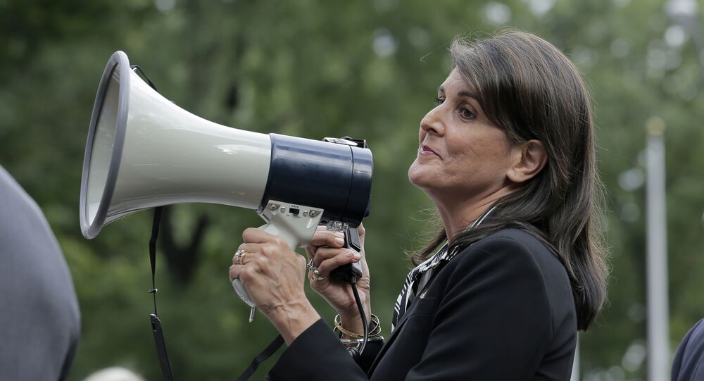 Surrounded by security, United States Ambassador to the United Nations Nikki Haley speaks briefly to people at a protest against Venezuelan President Nicolas Maduro outside United Nations headquarters in New York, Thursday, Sept. 27, 2018