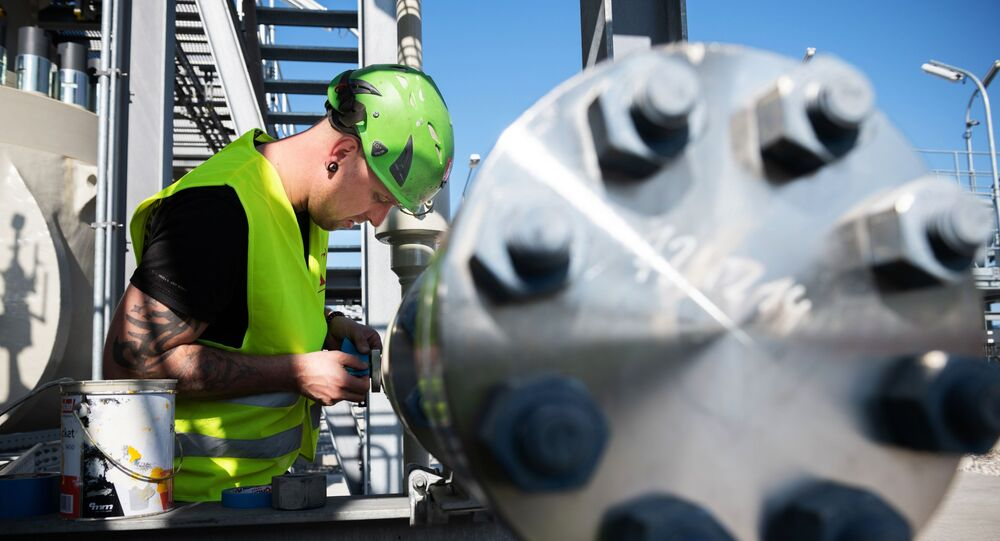 A Nord Stream 2 employee stands on a platform in the Nord Stream 2 Baltic Sea pipeline's receiving station, where six and a half million cubic meters of natural gas per hour will be processed and delivered to downstream pipelines at the right pressure, in Lubmin, Germany