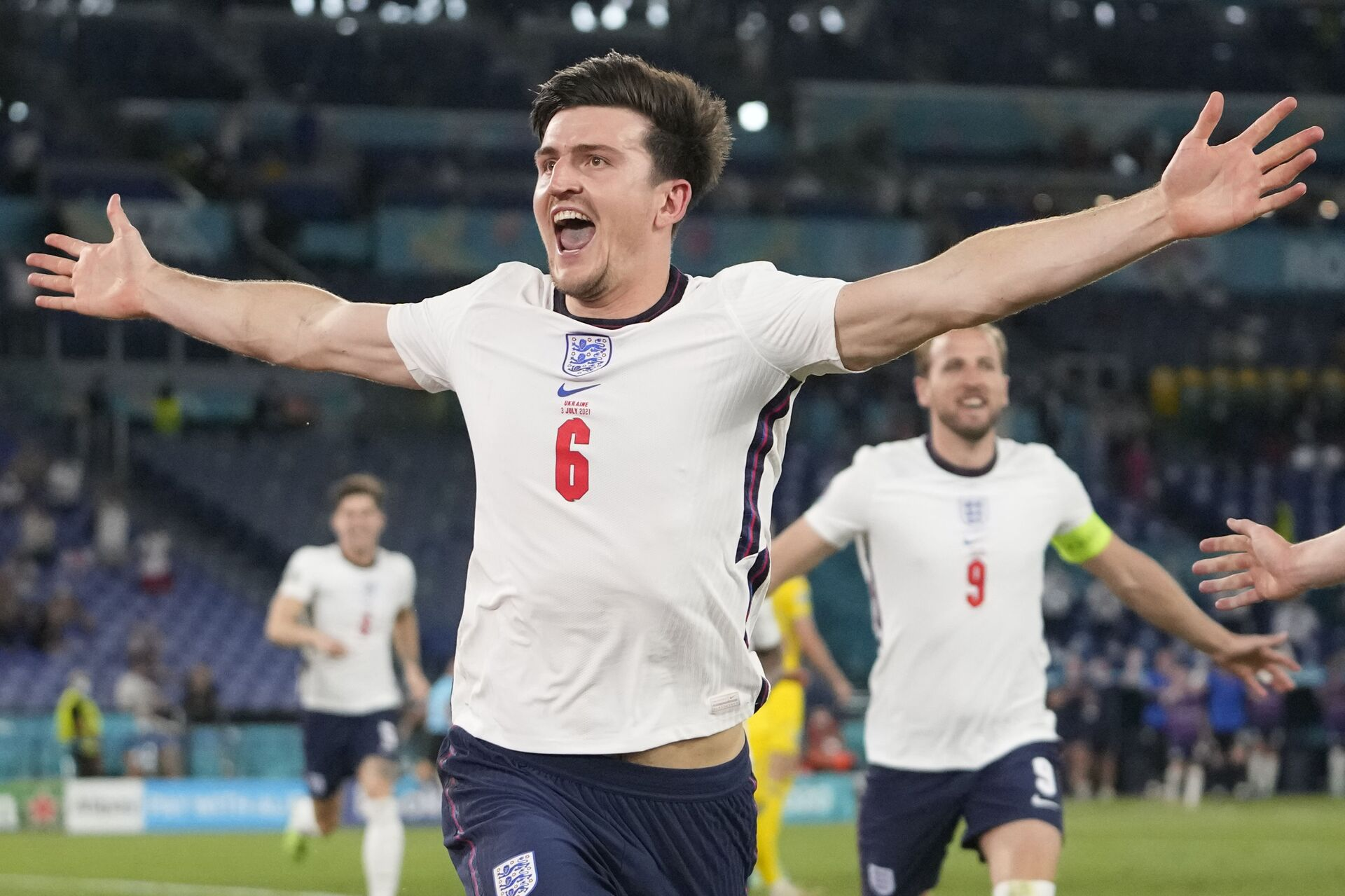 England's Harry Maguire celebrates after scoring his side's second goal during the Euro 2020 soccer championship quarterfinal match between Ukraine and England at the Olympic stadium in Rome at the Olympic stadium in Rome, Italy, Saturday, July 3, 2021 - Sputnik International, 1920, 07.09.2021