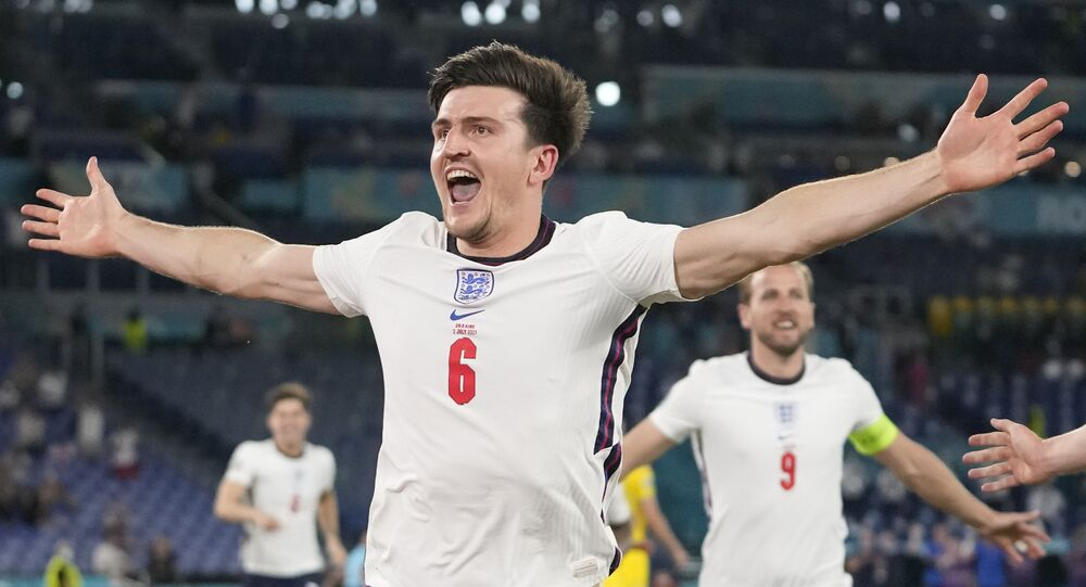 England's Harry Maguire celebrates after scoring his side's second goal during the Euro 2020 soccer championship quarterfinal match between Ukraine and England at the Olympic stadium in Rome at the Olympic stadium in Rome, Italy, Saturday, July 3, 2021