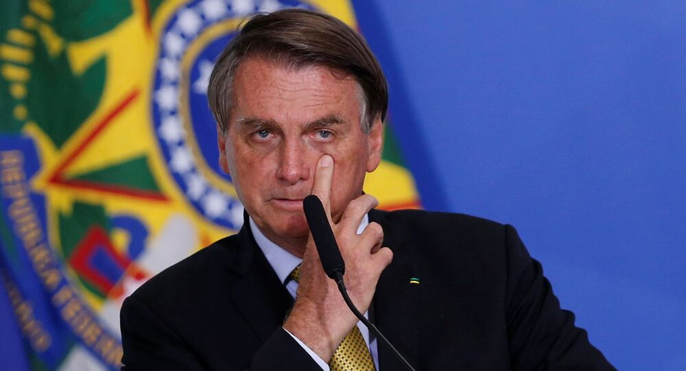 Brazil's President Jair Bolsonaro gestures during a ceremony at the Planalto Palace in Brasilia, Brazil, June 29, 2021