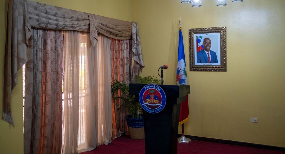 A picture of the late Haitian President Jovenel Moise hangs on a wall before a news conference by interim Prime Minister Claude Joseph at his house, almost a week after his assassination, in Port-au-Prince, Haiti July 13, 2021